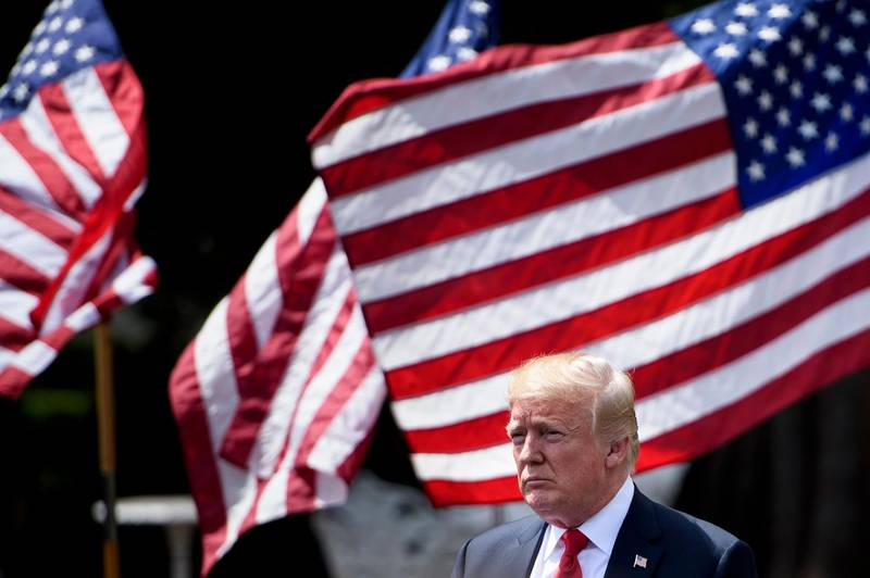 """(FILES) In this file photo taken on June 5, 2018 US President Donald Trump leaves after the """"Celebration of America"""" at the White House in Washington, DC. Trump announced on June 15, 2018 a series of tariffs of 25 percent targeting $50 billion in Chinese imports from """"industrially significant"""" technologies, making good on a pledge to punish the alleged theft of American intellectual property. In a statement, Trump also warned of """"additional tariffs"""" should China retaliate with countermeasures on American goods and services exports.  / AFP / Brendan Smialowski"""