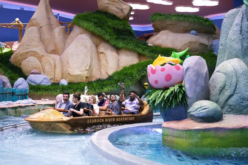 ABU DHABI, UNITED ARAB EMIRATES - JULY 24, 2018. The Flintstones Bedrock River Adventure at Bedrock land in Warner Bros World Abu Dhabi.Almost 15,000 tickets for Warner Bros World Abu Dhabi have been sold ahead of opening to the public on Wednesday.(Photo by Reem Mohammed/The National)Reporter: Section: NA + AL