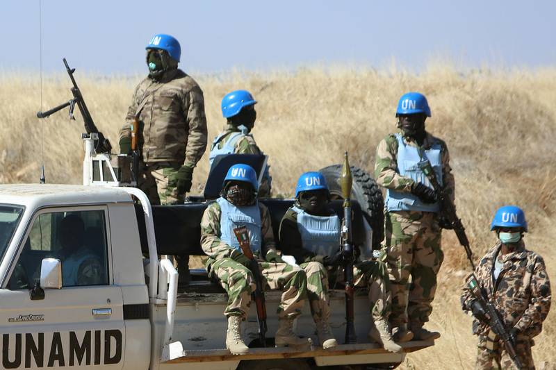 Members of the UN-African Union mission in Darfur (UNAMID) patrol the area near the city of Nyala in Sudan's Darfur on January 12, 2015. Qatar's deputy premier Ahmed bin Abdullah al-Mahmud is on a visit to the war-torn western region of Sudan for the ninth meeting of the committee monitoring the implementation of the Doha Document for Peace Darfur (DDPD). AFP PHOTO / ASHRAF SHAZLY (Photo by ASHRAF SHAZLY / AFP)