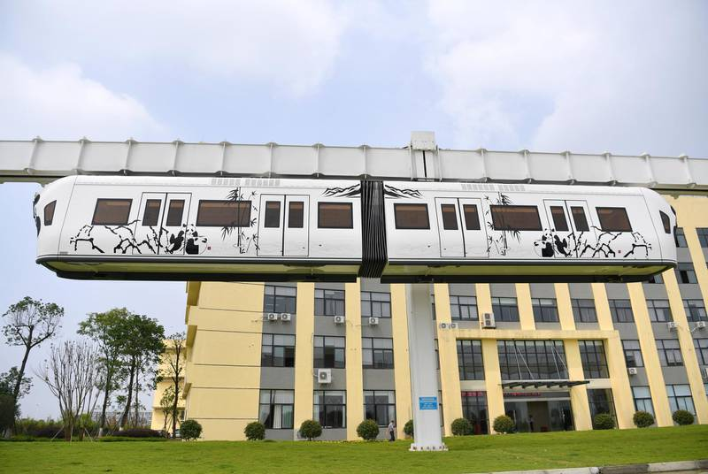 Mandatory Credit: Photo by Shutterstock (8969444l)An elevated new energy monorail train travels along a 1.4km air rail at China Sky Railway in Chengdu city, southwest China's Sichuan provinceWorld's first new energy air train created, Chengdu city, Sichuan Province, China - 18 Jul 2017This new energy test air rail was set up in 5 meters above the ground with ''U'' shape and total length of 1.4km. China is the third country to create air rail hot on the heels of Japan and Germany. But what's the difference is this Chinese air train is driven by Lithium battery pack instead of high tension electricity. This is the first creation in the whole world. The operation noise of this air train is much lower than those wheel-track ones. What's more, it has no exhaust gas pollution and electromagnetic radiation. Constructed in the air, this air train will not affect the ground transportation.
