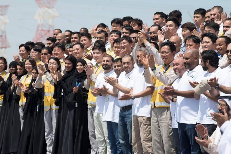 AL DHAFRA, ABU DHABI, UNITED ARAB EMIRATES - March 26, 2018: Emirates Nuclear Energy Corporation employees participate in the Unit One Construction Completion Celebration at Barakah Nuclear Energy Plant.   ( Abdullah Al Junaibi ) ---