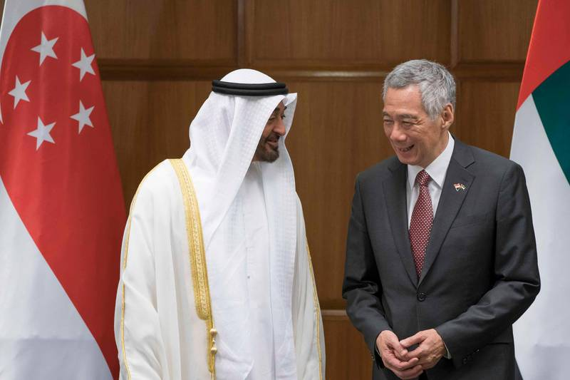SINGAPORE, SINGAPORE - February 28, 2019: HH Sheikh Mohamed bin Zayed Al Nahyan, Crown Prince of Abu Dhabi and Deputy Supreme Commander of the UAE Armed Forces (L) and HE Lee Hsien Loong, Prime Minister of Singapore (R), stands prior to a Memorandum of Understanding ceremony, at the Parliamant of Singapore.   ( Eissa Al Hammadi for the Ministry of Presidential Affairs ) ---