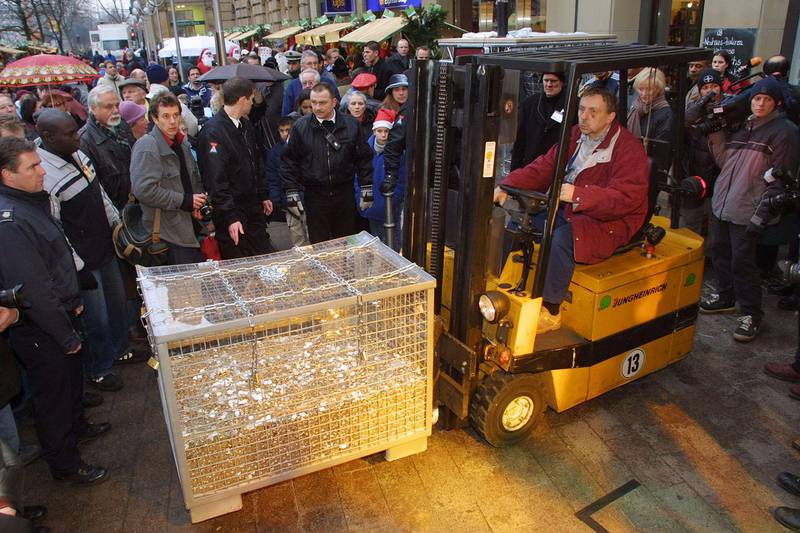 398746 12: A forklift moves 40,000 Euro coins at a Euro promotional event December 17, 2001 in Frankfurt, Germany, the day banks started distributing the first so-called Starter Kits of Euro coins to the German public. Twelve of the 15 European Union member states will officially adopt the Euro to replace their national currencies as of January 1, 2002. (Photo by Sean Gallup/Getty Images)