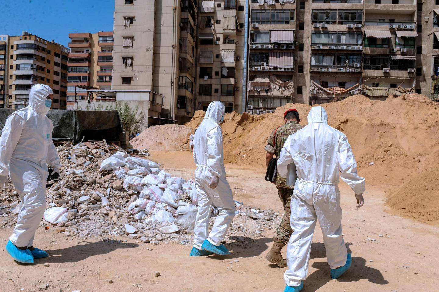 epa07792264 Investigators of Lebanon's military intelligence inspect the site after an alleged attack carried by two Israeli drones, in the southern suburb of Beirut, Lebanon, 25 August 2019. According to the Lebanese Armed Forces (LAF), two Israeli drones violated the Lebanese airspace over the southern suburbs of Beirut, adding that one fell down while the second exploded causing material damage. Hezbollah media office said that the drone caused damage to its media center, hours after Israel launched air strikes in Damascus, Syria.  EPA/NABIL MOUNZER