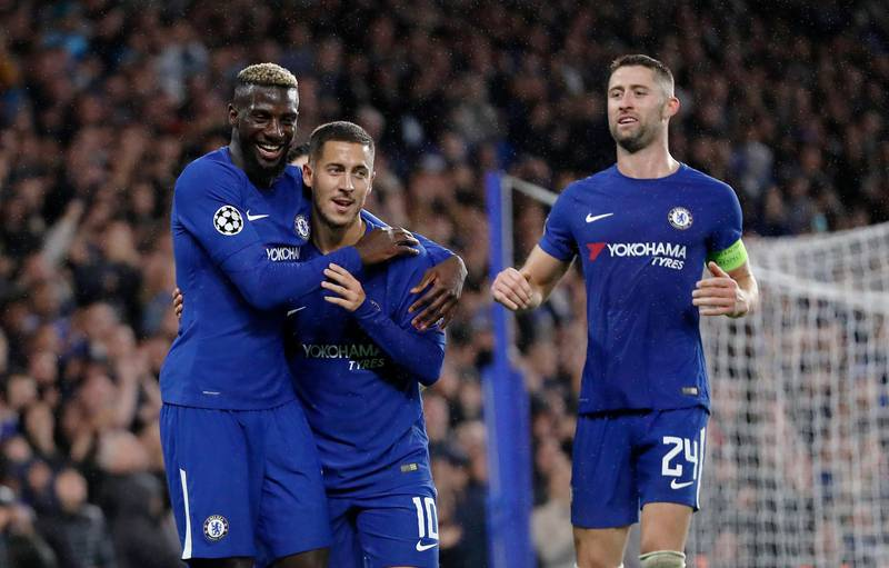 Chelsea's Tiemoue Bakayoko, left, celebrates with his teammates Eden Hazard, center, and Gary Cahill after scoring during the Champions League group C soccer match between Chelsea and Qarabag at Stamford Bridge stadium in London, Tuesday, Sept. 12, 2017. (AP Photo/Kirsty Wigglesworth)