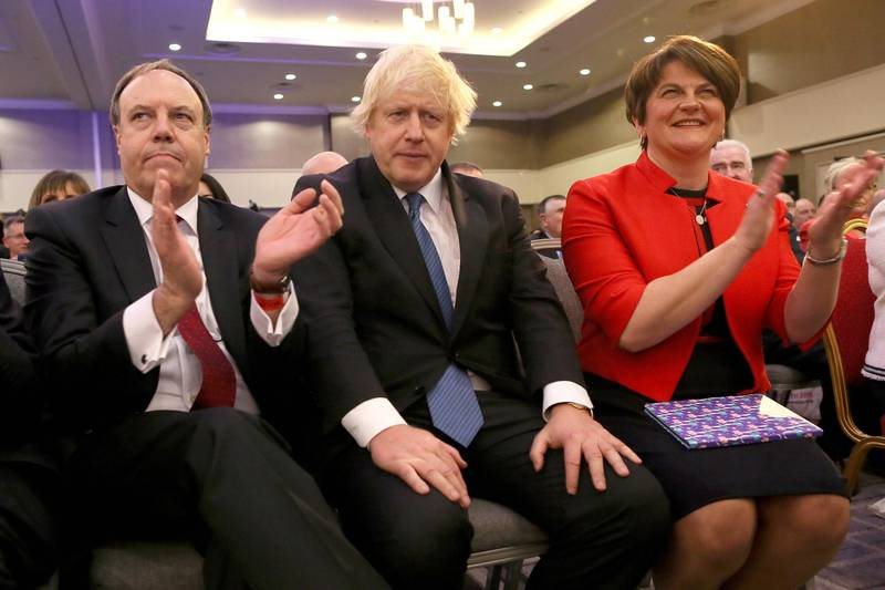 (FILES) In this file photo taken on November 24, 2018, (L-R) Deputy Leader of the DUP (Democratic Unionist Party), Nigel Dodds, former British Foreign Secretary Boris Johnson and leader of the DUP Arlene Foster attend the Democratic Unionist Party (DUP), Annual Conference in Belfast. The fate of Boris Johnson's draft Brexit agreement now rests squarely with Arlene Foster -- a Northern Irish ultra-conservative whose father was shot in the head by the IRA. / AFP / Paul FAITH