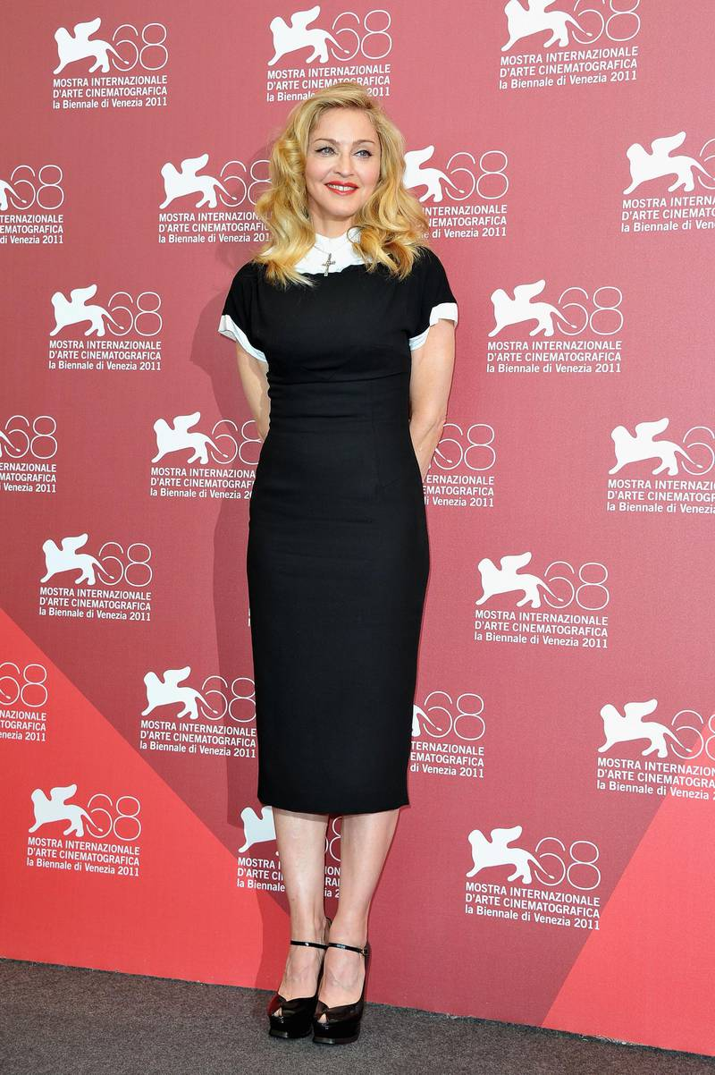 """VENICE, ITALY - SEPTEMBER 01:  Director/writer Madonna poses during the""""W.E."""" photocall at the Palazzo Del Cinema during the 68th Venice Film Festival on September 1, 2011 in Venice, Italy.  (Photo by Pascal Le Segretain/Getty Images)"""