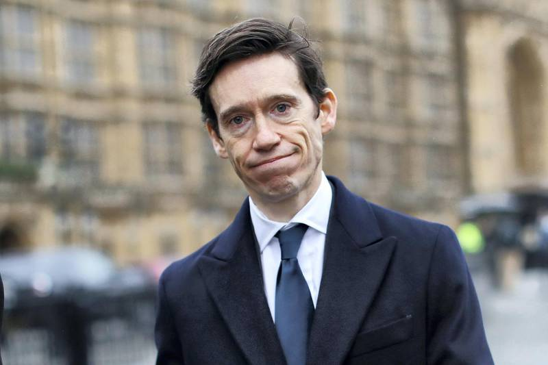 """Conservative MP Rory Stewart reacts as he walks past the Houses of Parliament in central London on January 16, 2019. - Prime Minister Theresa May was left """"crushed"""" and """"humiliated"""", Britain's newspapers said today as they raked over the fallout from parliament's huge rejection of her EU divorce deal. (Photo by Tolga AKMEN / AFP)"""