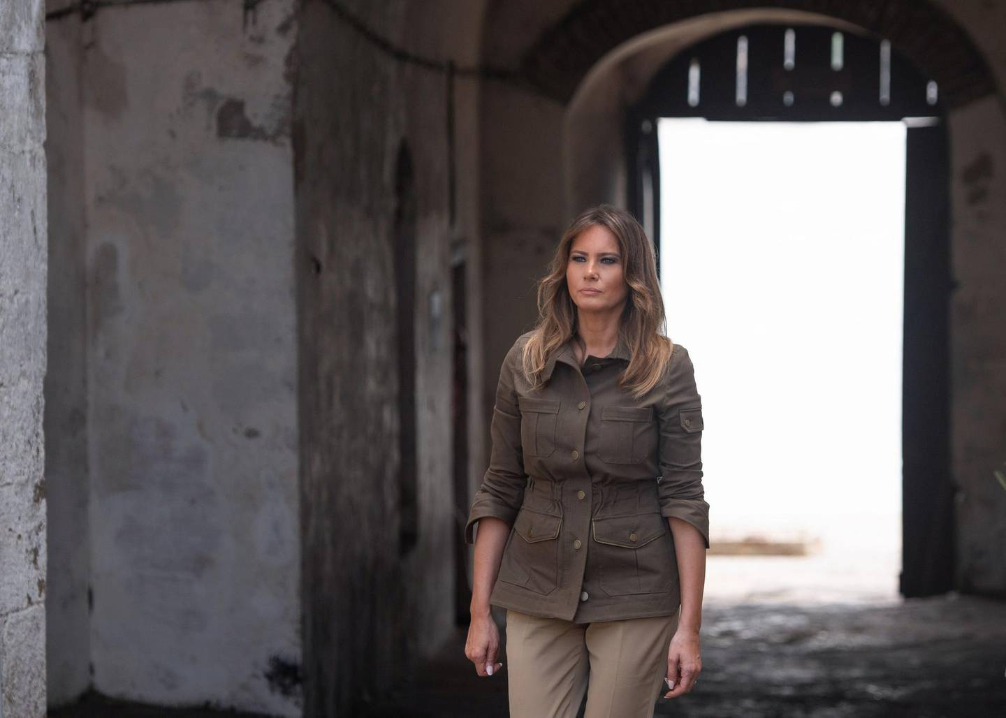 US First Lady Melania Trump walk through the Door of No Return (where slaves were loaded onto ships and sold in the Americas) as she tours the Cape Coast Castle, a former slave trading fort, in Cape Coast, Ghana, on October 3, 2018. US First Lady Melania Trump is on a solo tour of Africa to promote her children's welfare programme. / AFP / SAUL LOEB