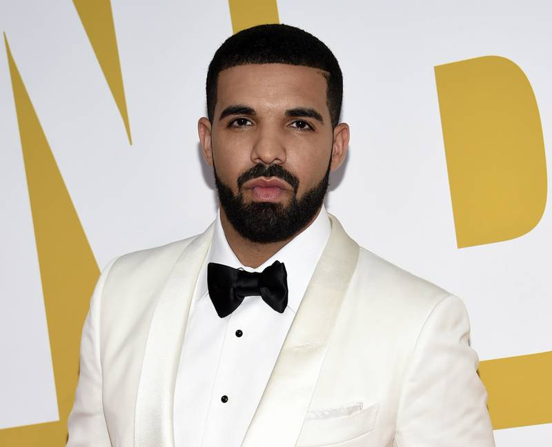 """FILE - In this June 26, 2017 file photo, Canadian rapper Drake arrives at the NBA Awards in New York. Drake is the Spotify's most-streamed artist of the year globally. Spotify announced Tuesday, Dec. 4, 2018, that the rapper earned 8.2 billion streams in 2018. He also has the year's most-streamed album and song with """"Scorpion"""" and """"God's Plan."""" (Photo by Evan Agostini/Invision/AP, File)"""