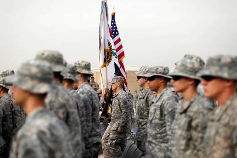 U.S. soldiers carry an U.S. national flag, an Iraq national flag, and the U.S. Forces in Iraq colors during ceremonies marking the end of the U.S. military mission, in Baghdad December 15, 2011. The U.S military officially ended its war in Iraq on Thursday, packing up a military flag at a ceremony with U.S. Defense Secretary Leon Panetta nearly nine years after the invasion that ousted Saddam Hussein.     REUTERS/Pablo Martinez Monsivais/Pool (IRAQ - Tags: POLITICS MILITARY CONFLICT) *** Local Caption ***  SIN61_IRAQ-WITHDRAW_1215_11.JPG