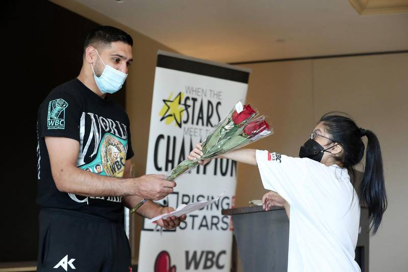 DUBAI, UNITED ARAB EMIRATES , December 28 – 2020 :- Suha Aziz giving flowers to Amir Khan, British professional boxer during the Rising Stars (people with determination) event held at the Fairmont The Palm hotel on Palm Jumeirah in Dubai. ( Pawan Singh / The National ) For News/Online/Instagram. Story by Kelly