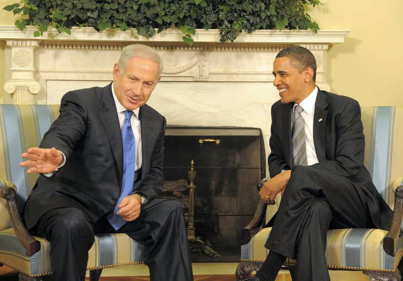 A handout picture released by the Israeli Government Press Office shows Israeli Prime Minister Benjamin Netanyahu (L) and US President Barack Obama smiling during their meeting at the White House in Washintong D.C. on May 18, 2009. The two leaders met at the Oval Office for an intense first summit which stretched an hour over its allotted time of two hours, coming amid signs of tension between two allies with new leaders at the helm. Netanyahu stopped short of talking of a future Palestinian state, in friendly but frank exchanges in front of the cameras. AFP PHOTO/HO/GPO/MOSHE MILNER    ++ RESTRICTED TO EDITORIAL USE    ++  ISRAEL OUT ++ (Photo by MOSHE MILNER / GPO / AFP)
