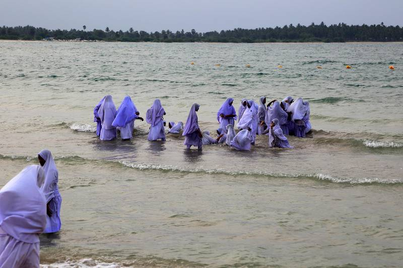 Muslim girls bathing in their clothes, Pasikudah Bay, Eastern Province, Sri Lanka, Asia. (Photo by: GeographyPhotos/Universal Images Group via Getty Images)