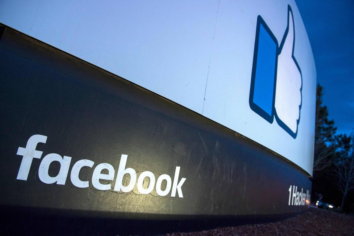 """(FILES) In this file photo taken on March 21, 2018 a lit sign is seen at the entrance to Facebook's corporate headquarters location in Menlo Park, California. Facebook said March 28, 2018 it would overhaul its privacy settings tools to put users """"more in control"""" of their information on the social media website.""""We've heard loud and clear that privacy settings and other important tools are too hard to find and that we must do more to keep people informed,"""" Chief Privacy Officer Erin Egan and Deputy General Counsel Ashlie Beringer said in a blog post.""""We're taking additional steps in the coming weeks to put people more in control of their privacy,"""" they confirmed.  / AFP PHOTO / JOSH EDELSON"""