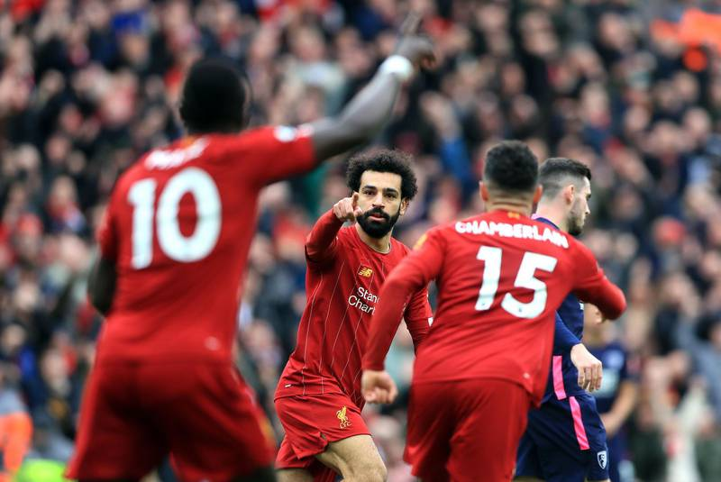 """Liverpool's Mohamed Salah (centre) celebrates scoring his sides first goal of the game with teammates during the Premier League match at Anfield, Liverpool. PA Photo. Picture date: Saturday March 7, 2020. See PA story SOCCER Liverpool. Photo credit should read: Mike Egerton/PA Wire. RESTRICTIONS: EDITORIAL USE ONLY No use with unauthorised audio, video, data, fixture lists, club/league logos or """"live"""" services. Online in-match use limited to 120 images, no video emulation. No use in betting, games or single club/league/player publications."""