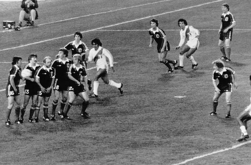 Scottish players forming a wall watch as the ball passes them into the goal for the third goal for Peru during the Football World Cup match between Scotland and Peru in Cordoba, Argentina on June 3, 1978. Peru defeated Scotland 3-1. (AP Photo)