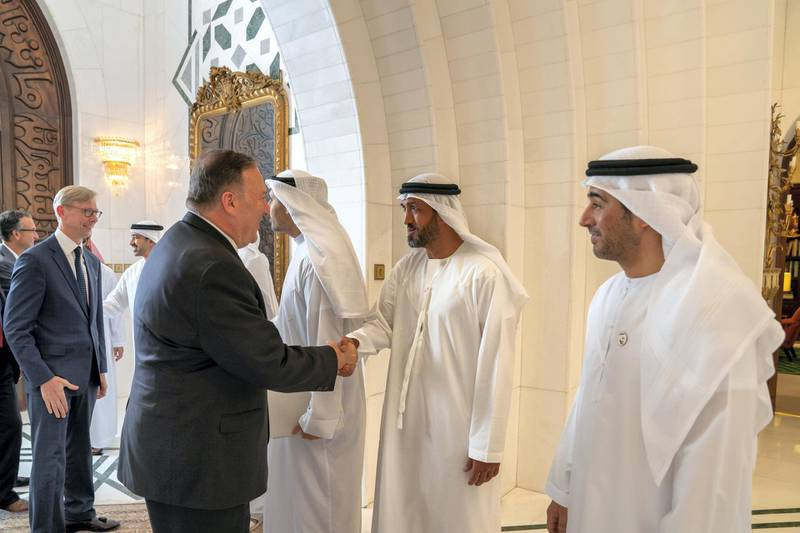 ABU DHABI, UNITED ARAB EMIRATES - September 19, 2019: HE Mohamed Mubarak Al Mazrouei, Undersecretary of the Crown Prince Court of Abu Dhabi (2nd R), greets Michael R Pompeo, Secretary of State of the United States of America (L), prior to a meeting the Sea Palace. Seen with HE Ali Saeed Al Neyadi (R).   ( Mohamed Al Hammadi / Ministry of Presidential Affairs ) ---