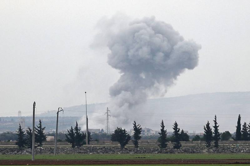 A picture taken from the town of Sarmin in northwestern Syria on February 21, 2020 shows smoke billowing over the village of Qaminas, about 6 kilometres southeast of Idlib city, following reported Syrian air strikes.   / AFP / Omar HAJ KADOUR