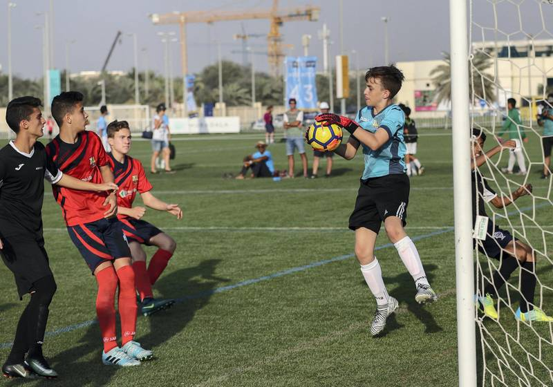 Abu Dhabi, March 24, 2018.  Manchester City Abu Dhabi Cup for juniors. CS Luceafarul gpalkeeper saves a goal attempt from  Muscat Football Academy in the Under 14 finals match.Victor Besa / The NationalSportsReporter:  Amith Passela