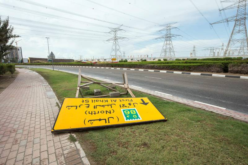 Dubai, United Arab Emirates - A signage downed by the strong wind at Ibn Batuta area.  Ruel Pableo foir The National