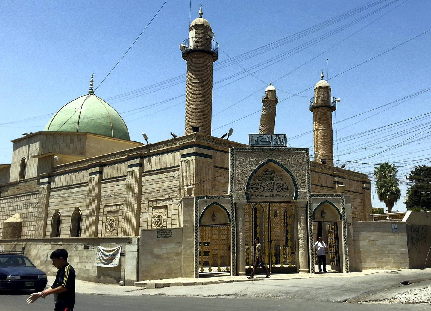 epa06041871 (FILE) - People walk in front of the Al-Noori Al-Kabeer mosque in Mosul, Iraq, 09 July 2014 (reissued 21 June 2017). According to media reports on 21 June 2017 citing Iraq's military, the Great Mosque of al-Nuri and its leaning minaret have been destroyed by members of the Islamic State militant group. Abu Bakr al-Baghdadi, the leader of the Sunni extremist group IS appeared for the first time in public at the mosque to declared caliphate on 04 July 2014.  EPA/STR *** Local Caption *** 53599216