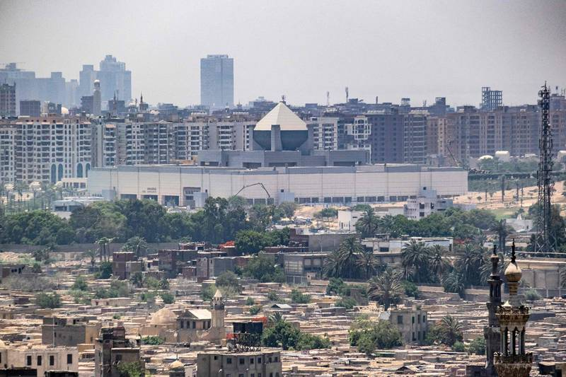 This picture taken on May 26, 2021 from the Cairo Citadel overlooking the Egyptian capital shows a view of the new National Museum of Egyptian Civilisation (NMEC), which currently houses a collection of mummies dating to the New Kingdom period of Ancient Egyptian history.  / AFP / Amir MAKAR