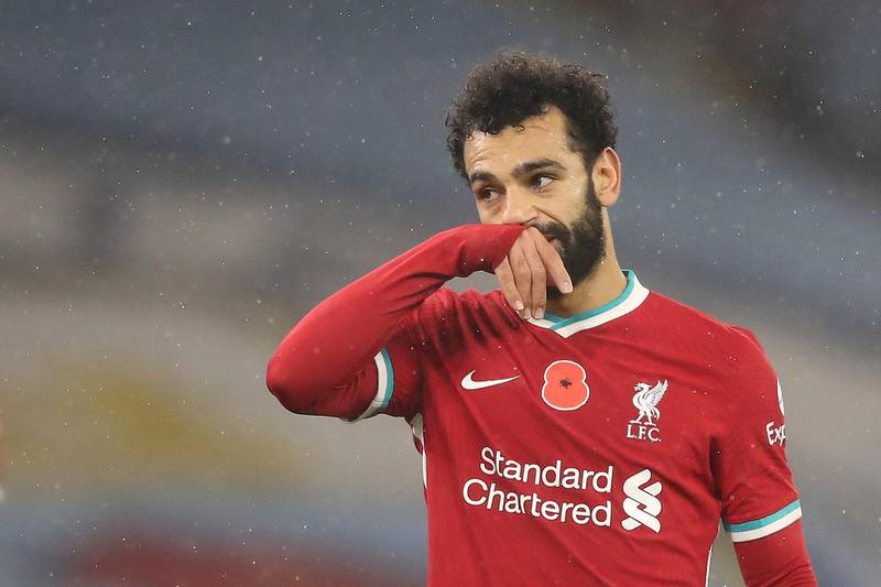 epa08808533 Mohamed Salah of Liverpool reacts during the English Premier League soccer match between Manchester City and Liverpool FC in Manchester, Britain, 08 November 2020.  EPA/Martin Rickett / POOL EDITORIAL USE ONLY. No use with unauthorized audio, video, data, fixture lists, club/league logos or 'live' services. Online in-match use limited to 120 images, no video emulation. No use in betting, games or single club/league/player publications.