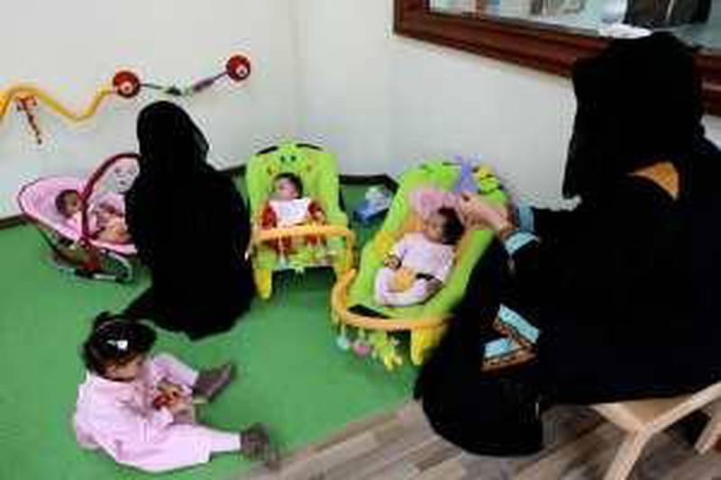 DUBAI, UNITED ARAB EMIRATES Ð Jan 19: Staff of the childcare care center with some of the kids at the childcare center in the Dubai Customs building in Dubai. (Pawan Singh / The National) For News. Story by Zoi Constantine *** Local Caption ***  PS1901- CHILDCARE11.jpg