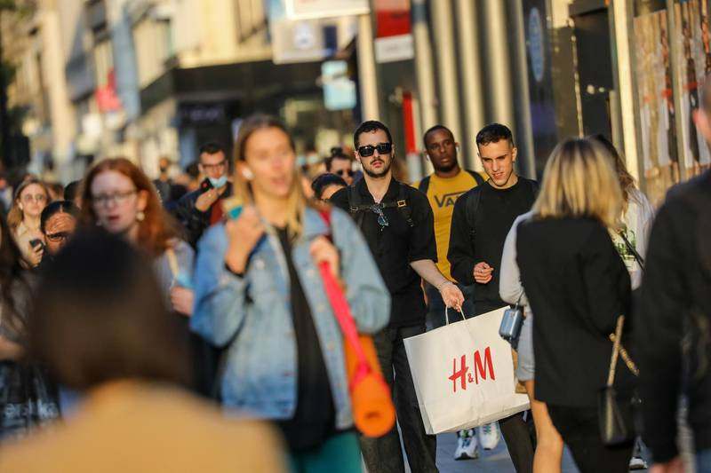 Pedestrians walk along Oxford Street in central London, U.K., on Thursday, Sep. 17, 2020. U.K. retail sales extended their recovery in August as a government initiative to boost the hospitality industry lured locked-down Britons out to the shops. Photographer: Simon Dawson/Bloomberg
