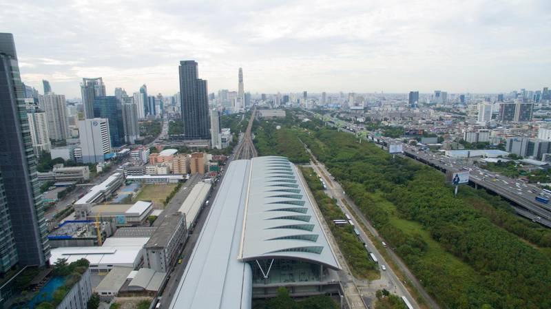 FBKK82 A aerial view of Makkasan airport rail link station Bangkok, Thailand looking east.