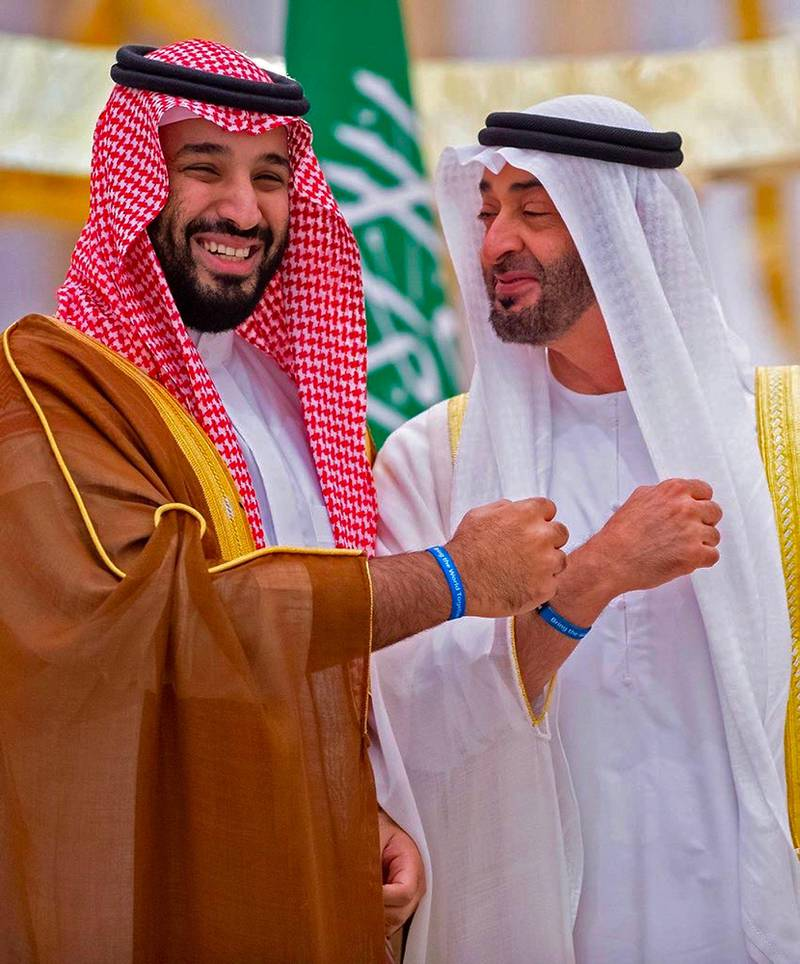 """A handout picture provided by the Saudi Royal Palace on November 27, 2019, shows Abu Dhabi Crown Prince Sheikh Mohammed bin Zayed Al-Nahyan welcoming Saudi Crown Prince Mohammed bin Salman (L) in Abu Dhabi.  Mohammed bin Salman visited the United Arab Emirates, as efforts to end the nearly five-year war in Yemen gain momentum. Riyadh and Abu Dhabi are close allies and key members of a military coalition backing the government in Yemen against the Iran-aligned Huthi rebels. - RESTRICTED TO EDITORIAL USE - MANDATORY CREDIT """"AFP PHOTO / SAUDI ROYAL PALACE / BANDAR AL-JALOUD"""" - NO MARKETING - NO ADVERTISING CAMPAIGNS - DISTRIBUTED AS A SERVICE TO CLIENTS  / AFP / Saudi Royal Palace / Bandar AL-JALOUD / RESTRICTED TO EDITORIAL USE - MANDATORY CREDIT """"AFP PHOTO / SAUDI ROYAL PALACE / BANDAR AL-JALOUD"""" - NO MARKETING - NO ADVERTISING CAMPAIGNS - DISTRIBUTED AS A SERVICE TO CLIENTS"""