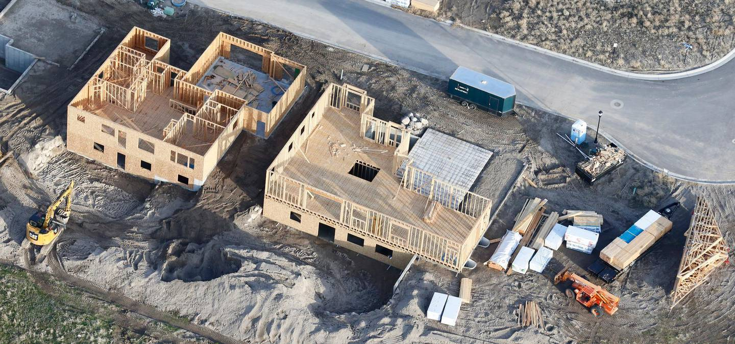 ADVANCE FOR RELEASE SATURDAY MAY 25, 2019, AND THEREAFTER - This April 13, 2019, photo, shows homes being built in suburban Salt Lake City. For millennials looking to buy their first home, the hunt has felt like an anxious race against the clock. (AP Photo/Rick Bowmer)