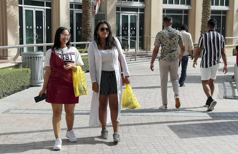 DUBAI , UNITED ARAB EMIRATES , April 4 – 2019 :- Left to Right – Winnie Vilander and Chonay Louw holding their plastic bags after doing shopping at the Spinneys  supermarket in Dubai Marina in Dubai. ( Pawan Singh / The National ) For News. Story by Patrick