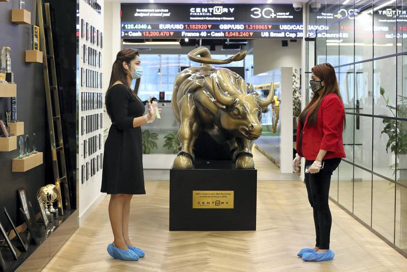Dubai, United Arab Emirates - Reporter: N/A. Standalone. Covid-19/Coronavirus. Colleagues Deepika and Shilpa (R) chat at Century Financial. Employees are required to wear masks, gloves and over shoes. Thursday, August 27th, 2020. Dubai. Chris Whiteoak / The National