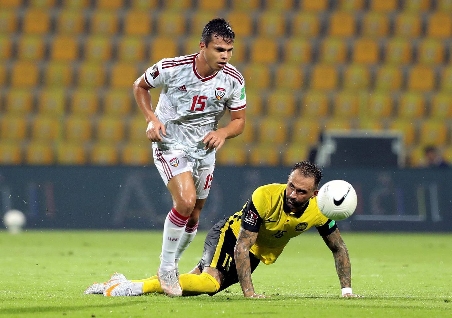 Fabio De Lima of the UAE battles with Guilherme Lucrecio of Malaysia during the game between the UAE and Malaysia in the World cup qualifiers at the Zabeel Stadium, Dubai on June 3rd, 2021. Chris Whiteoak / The National.  Reporter: John McAuley for Sport