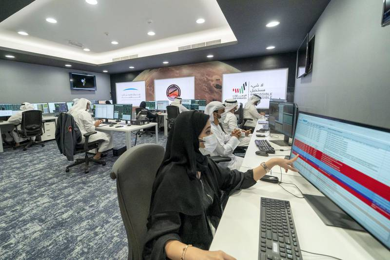 DUBAI, UNITED ARAB EMIRATES - February 09, 2021: Members of Mohammed Bin Rashid Space Centre participate during the arrival of the Hope Probe in the orbit of Mars.  ( Mohamed Al Hammadi / Ministry of Presidential Affairs ) ---