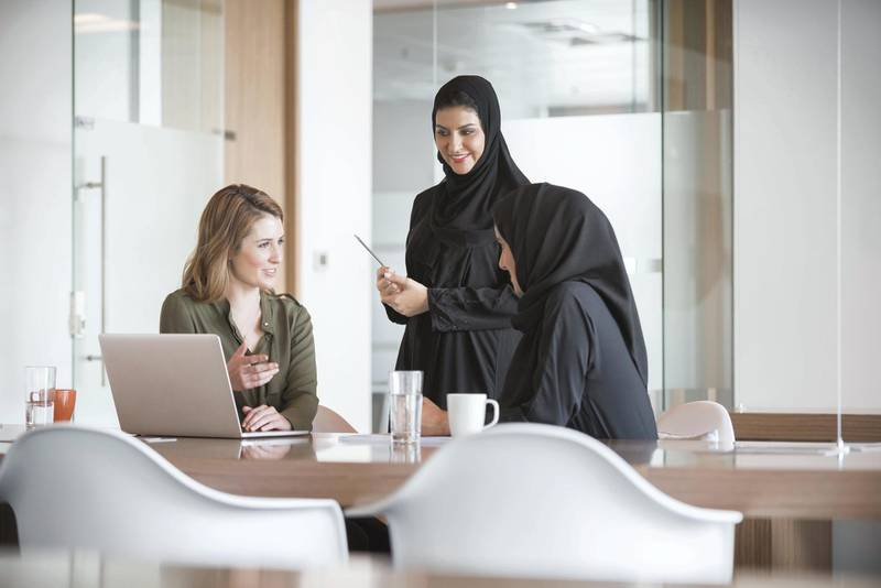 A photo of multi-ethnic businesswomen discussing in modern office in the Middle East. Multiracial Arab and Caucasian professional women are at conference table in modern middle eastern workplace. Getty Images