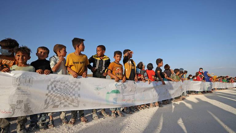 An image that illustrates this article Syrian refugee children draw for International Day of Peace - in pictures