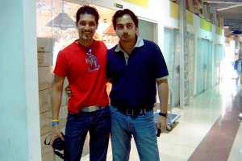 Undated handout phtograph of Saad Khan (left red t-shirt) of Karachi who died during a Unilever sponsored reality TV show in Thailand. His friend Fahd Siddiqui is on the right