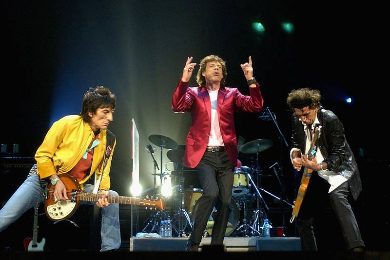 SYDNEY, AUSTRALIA - FEBRUARY 22:  (L-R)  Members of the Rolling Stones, Ronnie Woods, Mick Jagger and Keith Richards, perform live on stage at the Sydney Superdome February 22, 2003 in Sydney, Australia. The Rolling Stones will play in three major Australian cities as part of their 40 Licks World Tour 2003.  (Photo by Chris McGrath/Getty Images)