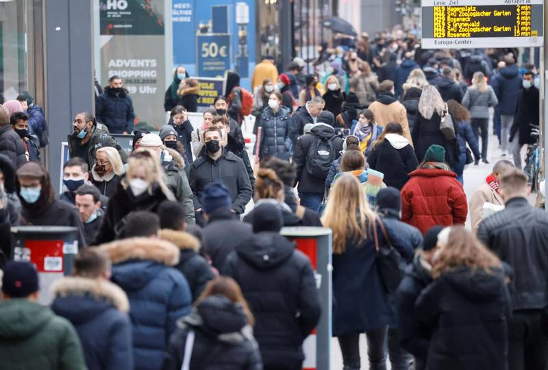 People with protective face masks walk at Tauentzienstrasse shopping boulevard, amid the coronavirus disease (COVID-19) outbreak in Berlin, Germany, December 5, 2020.    REUTERS/Fabrizio Bensch