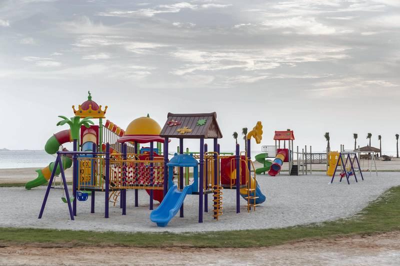 ABU DHABI, UNITED ARAB EMIRATES. 27 MAY 2018. Opening of Hudayriat beach next to Al Bateen beach.Playground facilities for kids. (Photo: Antonie Robertson/The National) Journalist: Haneen Dajani. Section: National.