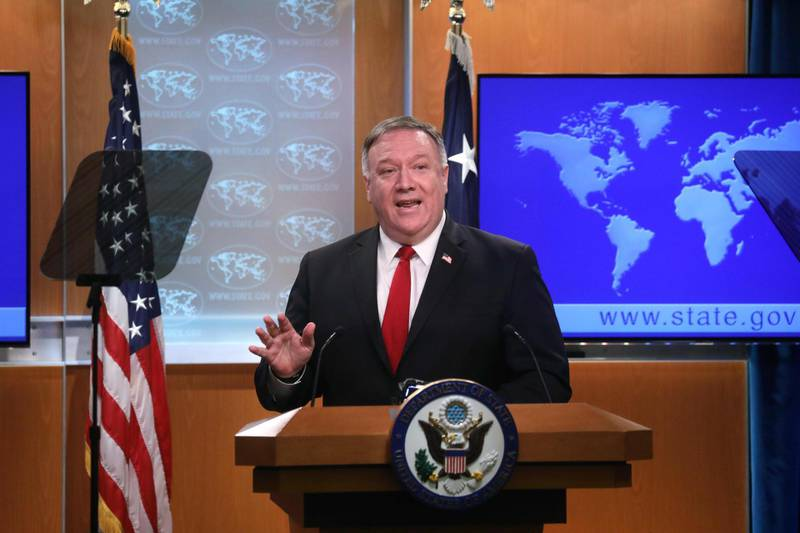 US Secretary of State Mike Pompeo addresses a news conference at the State Department in Washington,DC on April 7, 2020.  / AFP / POOL / LEAH MILLIS