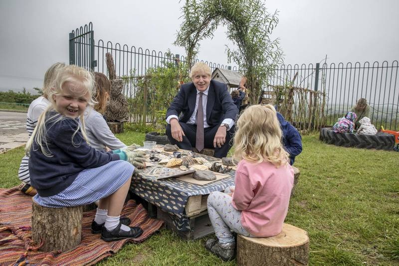 WADEBRIDGE, ENGLAND - JUNE 10: Prime Minister Boris Johnson visits the out door spaces to discuss environmental issues at the St Issey Primary school on June 10, 2021 near Wadebridge in Cornwall. UK Prime Minister, Boris Johnson, will host leaders from USA, Japan, Germany, France, Italy and Canada at the G7 Summit to be held in Carbis Bay, Cornwall - beginning Friday, June 11. This year the UK has invited India, South Africa, and South Korea to attend the Leaders' Summit as guest countries as well as the EU. (Photo by Jack Hill - WPA Pool/Getty Images)