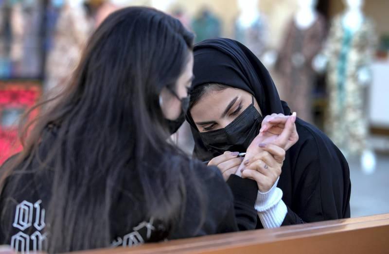 Abu Dhabi, United Arab Emirates, January 10, 2021.Henna at the UAE pavillon, Sheikh Zayed Festival.Victor Besa/The NationalSection:  NAReporter:  Saeed Saeed