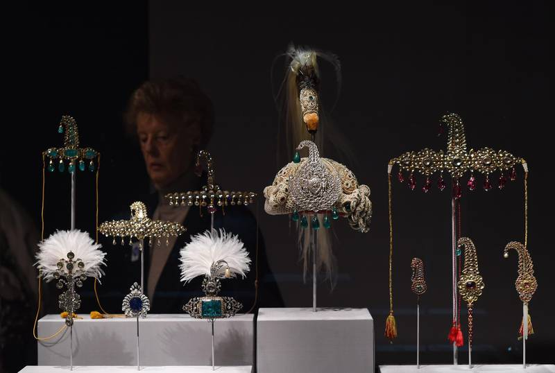 """(FILES) This file photo taken on October 27, 2014 shows jeweled objects on display during a press preview of an exhibition titled """"Treasures from India, Jewels from the Al-Thani collection"""" at the Metropolitan Museum of Art in New York.  Thieves made off with several items of Indian maharajahs' treasures owned by a member of the Qatari royal family after an audacious heist on January 3, 2017 at the Doge's palace in Venice, police said. Italian authorities investigating the theft put at around a million euros (USD 1.2 million) the overall value of the collection of Treasures of the Mughals and the Maharajahs on display. / AFP PHOTO / JEWEL SAMAD"""
