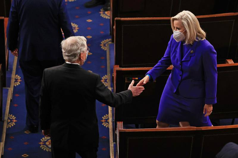 WASHINGTON, DC - APRIL 28: Sen. Mitch McConnell (R-KY) (L) greets Rep. Liz Cheney (R-WY) before U.S. President Joe Biden addresses a joint session of Congress in the House chamber of the U.S. Capitol April 28, 2021 in Washington, DC. On the eve of his 100th day in office, Biden spoke about his plan to revive America's economy and health as it continues to recover from a devastating pandemic. He delivered his speech before 200 invited lawmakers and other government officials instead of the normal 1600 guests because of the ongoing COVID-19 pandemic.   Chip Somodevilla/Getty Images/AFP == FOR NEWSPAPERS, INTERNET, TELCOS & TELEVISION USE ONLY ==