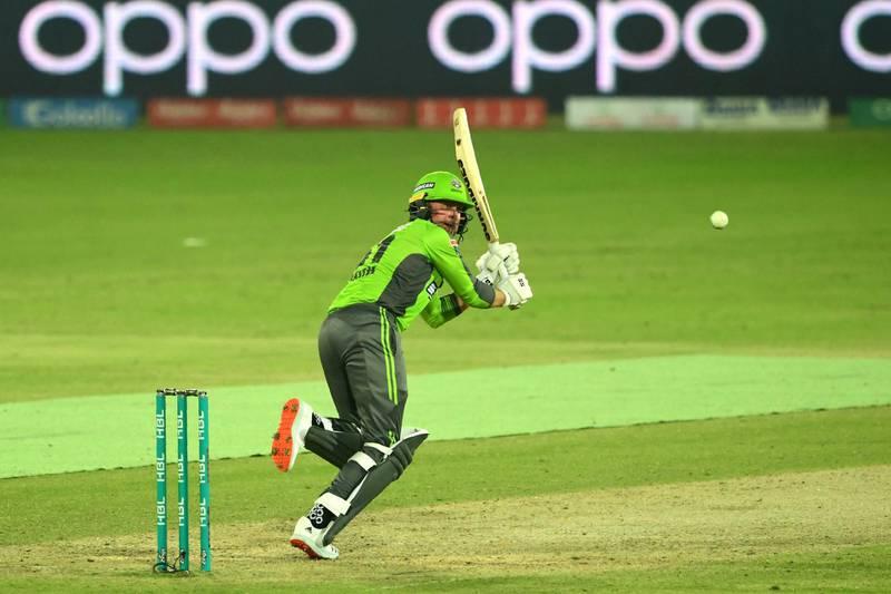 Lahore Qalandars Ben Dunk plays a shot during the Pakistan Super League (PSL) Twenty20 cricket match between the Peshawar Zalmi's and Lahore Qalandars at the National Stadium in Karachi on November 14, 2020. (Photo by Asif HASSAN / AFP)