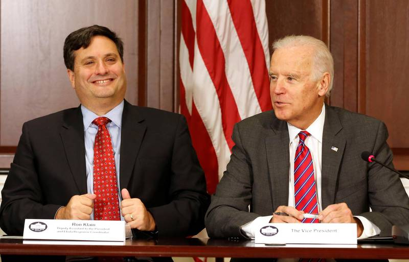 FILE PHOTO - U.S. Vice President Joe Biden (R) is joined by Ebola Response Coordinator Ron Klain (L) in the Eisenhower Executive Office Building on the White House complex in Washington, U.S. November 13, 2014.        REUTERS/Larry Downing/File Picture